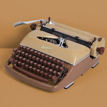 1958 Rheinmetall Typewriter. Restored and in excellent working conditon.Brown. Portable. With Case.