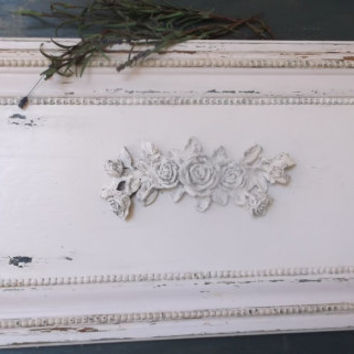 Sold wood panel wall decor distressed in white with beaded trim and large  in shabby rose bouquet in the center.