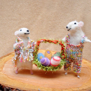 Easter decoration. Mouse couple wit basket full of easter eggs