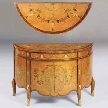 A GEORGE III ORMOLU-MOUNTED SATINWOOD, HAREWOOD, TULIPWOOD, PADOUK AND MARQUETRY COMMODE