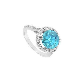 Blue Topaz and Diamond Ring : 14K White Gold - 1.25 CT TGW