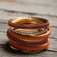 Textured Stacked Bangle Set - Coral from Jewelry & Accessories at Lucky 21 Lucky 21