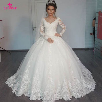 Gorgeous Sheer Ball Gown Wedding Dresses Puffy Lace Beaded Applique White Long Sleeve Arab Wedding Gowns robe de mariage