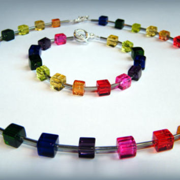 Rainbow  and silver glass bead bracelet with a toggle clasp