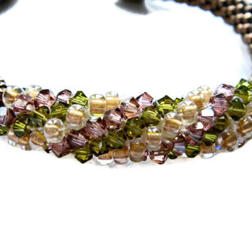Bead crochet spiral bracelet with Swarovski elements. Brown and gold