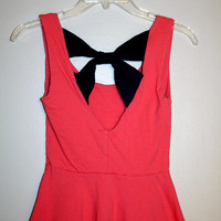 Coral Peplum Bow Top