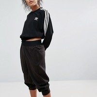 adidas Originals Black Three Stripe Cropped Chiffon Sweatshirt at asos.com