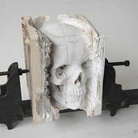 Skull Carved From Obsolete Computer Manuals | Geekologie
