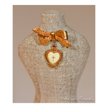 Vintage gold tone bow brooch, pin, dangling white heart cross locket, religious jewelry, women's jewelry, communion confirmation gift