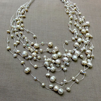 Large and small white pearl 5 strand necklace
