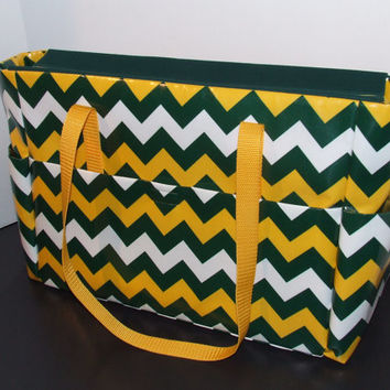 "Tote/Diaper bag in large chevron print,  with vinyl laminated fabric exterior. ""Go Packers, Steelers & Shockers!"