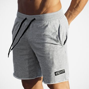 New Men's Gym Shorts Loose Sweatpants Fitness Trunks Jogging Sports Shorts Man Cotton Workout Training Short Trousers Breeches