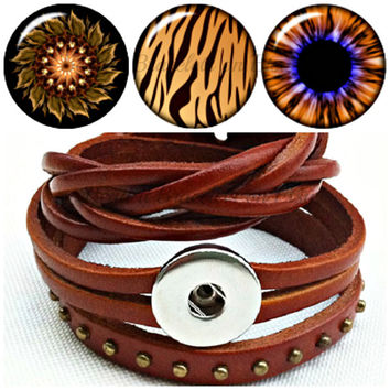 Adjustable leather wrap bracelet with 3 interchangeable Noosa style Snap Charms. Will fit Ginger snaps too.