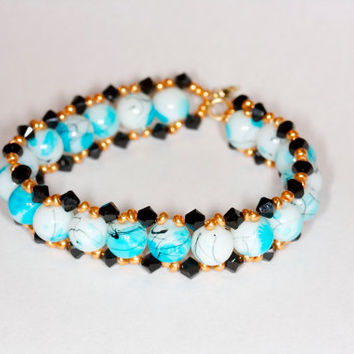 Blue handmade bracelet Blue and black handmade bracelet Blue beaded bracelet Glass beads and Swarovski bracelet Handmade beaded bracelet