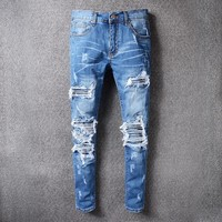 Men's blue pleated patchwork hole ripped biker jeans for motorcycle Casual distressed stretch denim pants