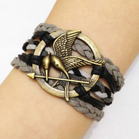 Antique Bronze The Hunger Games by HandmadeJewelry88 on Etsy