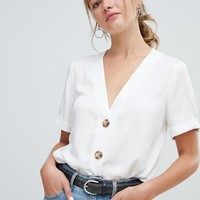 ASOS DESIGN boxy top with contrast buttons | ASOS