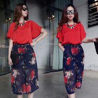 Red Angel Sleeve Cut-Out Back Blouse and Blue Floral Print Mesh Culotte Shorts