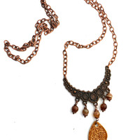Amber colored Ceramic and gemstone copper necklace.