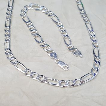 F180 Sterling Silver Italian Figaro Link, 8mm Wide, available in chain and bracelet.