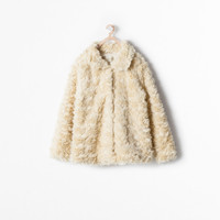 Short textured fur coat