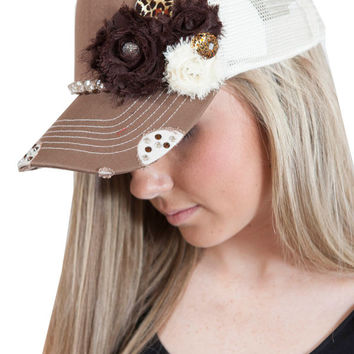 Mocha and cream trucker hat with rhinestone and floral embelishments