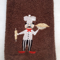 Chef Holding a Pie and a Rolling Pin embroidered on a brown cotton kitchen towel.  $11.00