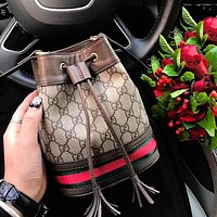 Gucci good fabric two-layer big pocket with four pockets inside. Top hardware and metal. Super worthy bucket bag Bronze