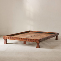 Eloisa Carved Wood Platform Bed | Urban Outfitters