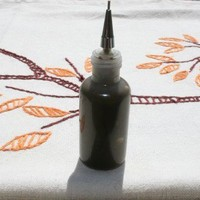 Henna paste made fresh in an applicator bottle for temporary tattoos