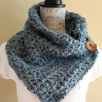Katniss Inspired cowl. Crochet Scarf. Infinity scarf. Button scarf. Made by Bead Gs on ETSY. Blue in color with hints of green.