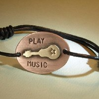 Bronze guitar handmade leather bracelet with copper and play music on Handmade Artists' Shop