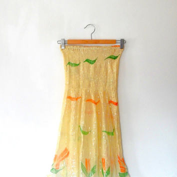 Pale yellow / tulip print  / flower / leaf / green / orange / gold / metallic / stripe / gold / metallic / sheer / strapless beach dress