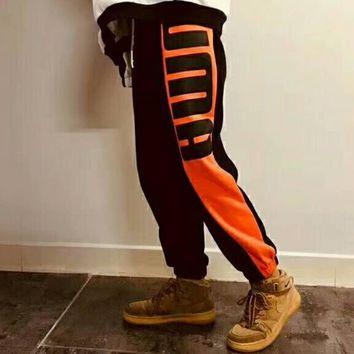 PUMA 2018 spring and summer new trend fashion casual wild trousers F-CR-CP-WM-YD Black+orange