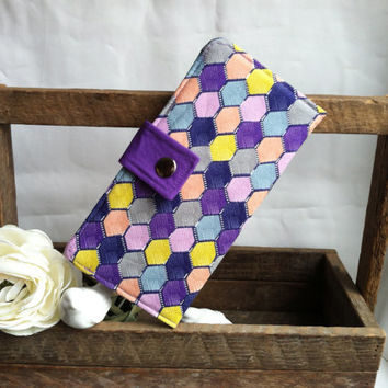Geometric colorful womens folded wallet in purples, blues, pinks. Coin pouch, bill slots, card slots