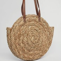 ASOS DESIGN straw circle shopper bag with water based pu strap at asos.com