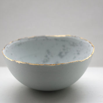 Stoneware Parian porcelain bowl in duck egg blue with mat gold rims mat interior and crystals.