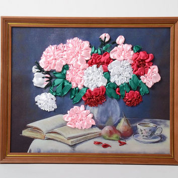 Small handmade satin ribbon flower embroidery in frame made of dark wood