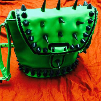 Green vinyl purse with black English studs and spikes