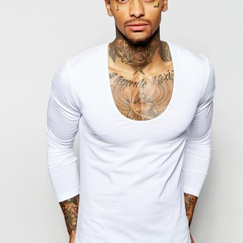 ASOS Extreme Muscle Fit Long Sleeve T-Shirt With Deep Scoop In White at asos.com