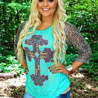 3/4 sleeve baseball top with lace and a cross.