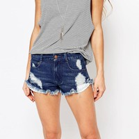 Honey Punch | Honey Punch Festival Denim Shorts With Distressing And Frayed Hems at ASOS