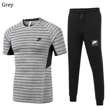 NIKE 2018 spring and summer men's outdoor sports running short-sleeved sportswear two-piece Grey