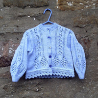 "Hand knitted girl's blue lacy patterned cardigan with fancy edge. 22"" chest"