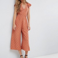 ASOS Jumpsuit with Twist Back and Frill Detail in Spot Print at asos.com