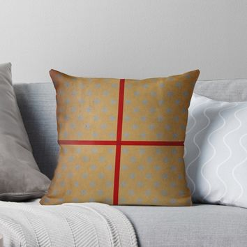 'Present wrapped in gold paper and red ribbon' Throw Pillow by steveball