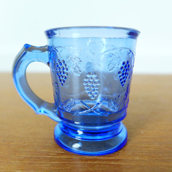 Blue EAPG miniature mug shot glass with grapevine pattern, pressed glass