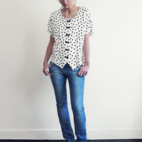 Black on white polkadot blouse with black leather bow buttons . Belle