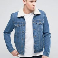 River Island Denim Jacket With Fleece Lining In Mid Wash at asos.com