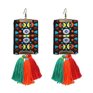 JEZA - Tribal Print Pom Pom Earrings